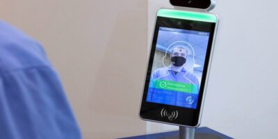 Facial recognition access station also checks body temperature