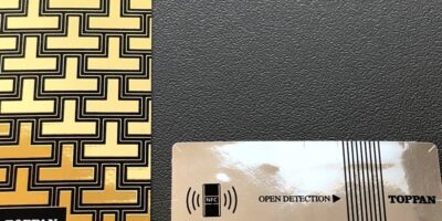 Metallic finish for NFC labels to enhance packaging